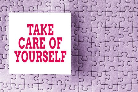 Text sign showing Take Care Of Yourself. Business photo showcasing a polite way of ending a gettogether or conversation Piece of square note paper use for give notation stick to puzzle background