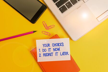 Conceptual hand writing showing Your Choices 1 Do It Now 2 Regret It Later. Concept meaning Think first before deciding Laptop smartphone clip pencil paper sheet colored background Banco de Imagens