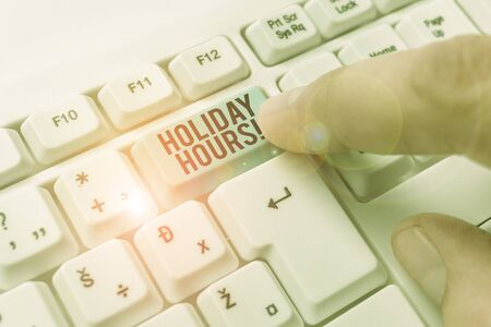 Text sign showing Holiday Hours. Business photo showcasing Overtime work on for employees under flexible work schedules Stock Photo