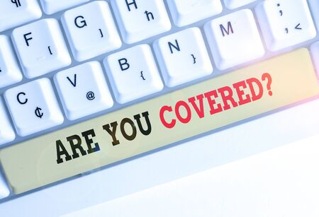 Conceptual hand writing showing Are You Covered Question. Concept meaning asking showing if they had insurance in work or life