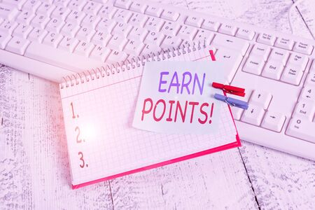 Handwriting text Earn Points. Conceptual photo collecting scores in order qualify to win big prize notebook paper reminder clothespin pinned sheet white keyboard light wooden