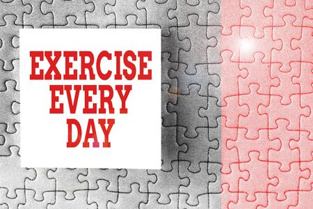 Text sign showing Exercise Every Day. Business photo showcasing move body energetically in order to get fit and healthy Piece of square note paper use for give notation stick to puzzle background