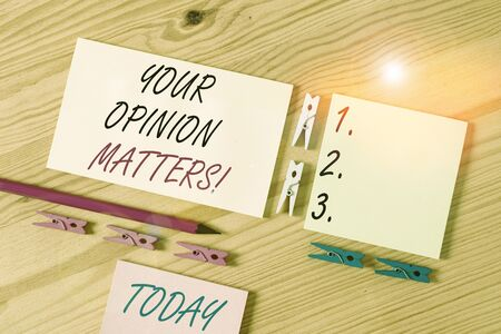 Word writing text Your Opinion Matters. Business photo showcasing show you do not agree with something that just been said Colored clothespin papers empty reminder wooden floor background office