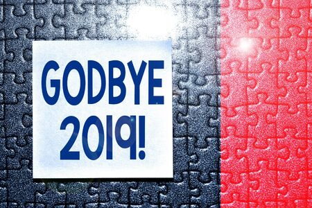 Handwriting text Godbye 2019. Conceptual photo express good wishes when parting or at the end of last year Piece of square note paper use for give notation stick to puzzle background