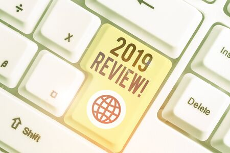 Word writing text 2019 Review. Business photo showcasing remembering past year events main actions or good shows Stock Photo