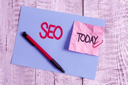 Text sign showing Seo. Business photo showcasing incredibly effective way to market your near business online Wrinkle paper and cardboard plus stationary placed above wooden background