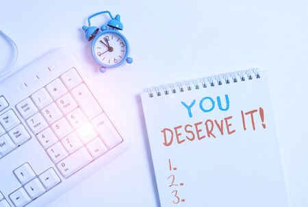 Writing note showing You Deserve It. Business concept for should have it because of their qualities or actions Keyboard with empty note paper and pencil white background