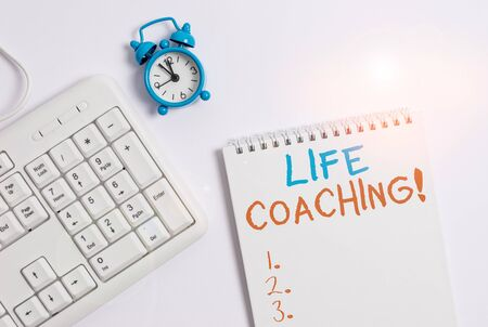 Writing note showing Life Coaching. Business concept for demonstrating employed to help showing attain their goals in career Keyboard with empty note paper and pencil white background Stock Photo