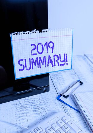 Conceptual hand writing showing 2019 Summary. Concept meaning summarizing past year events main actions or good shows Note paper taped to black screen near keyboard stationary
