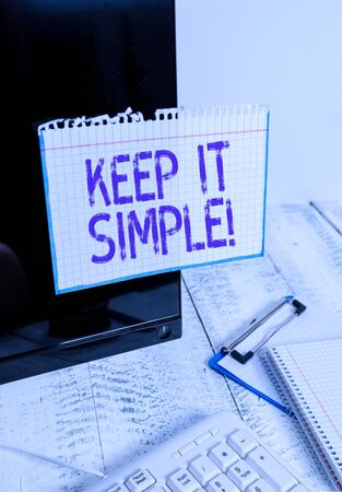 Conceptual hand writing showing Keep It Simple. Concept meaning ask something easy understand not go into too much detail Note paper taped to black screen near keyboard stationary