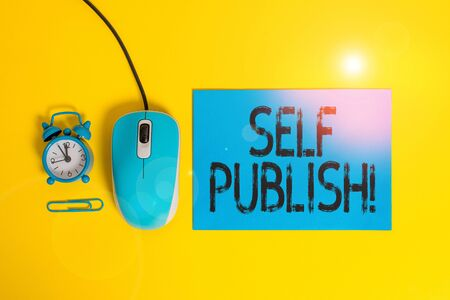 Word writing text Self Publish. Business photo showcasing writer publish piece of ones work independently at own expense Blank paper sheet alarm clock clip wire mouse gadget colored background