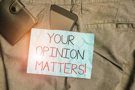 Text sign showing Your Opinion Matters. Business photo text show you do not agree with something that just been said Smartphone device inside trousers front pocket with wallet and note paper