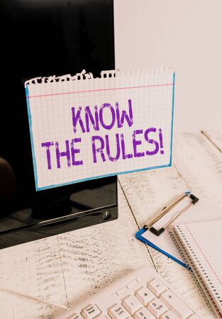 Conceptual hand writing showing Know The Rules. Concept meaning set explicit or regulation principles governing conduct Note paper taped to black screen near keyboard stationary