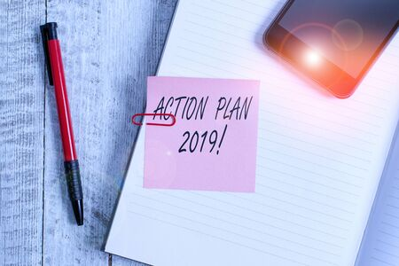 Handwriting text writing Action Plan 2019. Conceptual photo proposed strategy or course of actions for current year Thick pages notebook stationary placed above classic look wooden backdrop