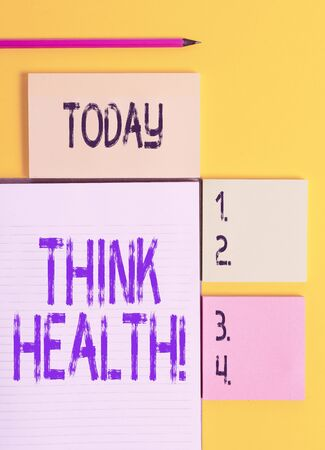 Handwriting text Think Health. Conceptual photo state of complete physical mental and social well being Colored empty papers with copy space on the yellow background table