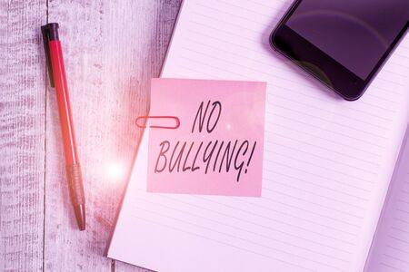 Handwriting text writing No Bullying. Conceptual photo stop aggressive behavior among children power imbalance Thick pages notebook stationary placed above classic look wooden backdrop