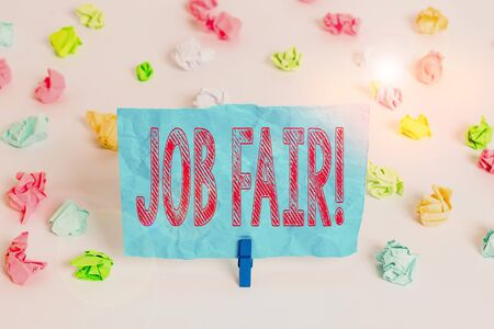 Conceptual hand writing showing Job Fair. Concept meaning event in which employers recruiters give information to employees Colored crumpled paper empty reminder white floor clothespin