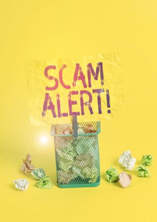 Conceptual hand writing showing Scam Alert. Concept meaning fraudulently obtain money from victim by persuading him Trash bin crumpled paper clothespin office supplies yellow