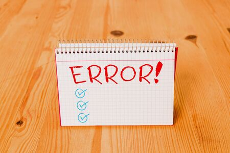 Handwriting text writing Error. Conceptual photo state or condition of being wrong in conduct judgement or program Empty reminder wooden floor background spiral notebook groove slot office