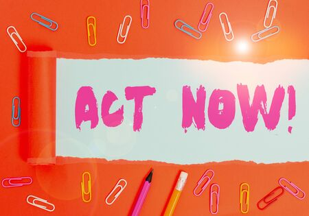 Word writing text Act Now. Business photo showcasing do not hesitate and start working or doing stuff right away Stationary and torn cardboard placed above a plain pastel table backdrop