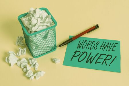 Handwriting text writing Words Have Power. Conceptual photo as they has ability to help heal hurt or harm someone crumpled paper trash and stationary with note paper placed in the trash can