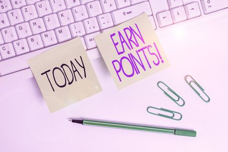 Word writing text Earn Points. Business photo showcasing collecting scores in order qualify to win big prize Square green note paper with pencil on the white background 版權商用圖片
