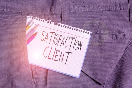 Word writing text Satisfaction Client. Business photo showcasing benefits which customers get from purchasing products Writing equipment and white note paper inside pocket of man work trousers