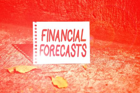 Handwriting text Financial Forecasts. Conceptual photo estimate of future financial outcomes for a company Empty Spiral Bound Notebook Sheet Torn Off Folded in Half Dried Leaves