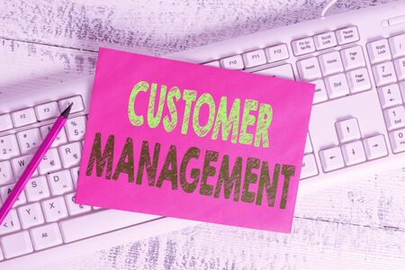Handwriting text writing Customer Management. Conceptual photo customer retention and ultimately driving sales growth White keyboard office supplies empty rectangle shaped paper reminder wood 版權商用圖片
