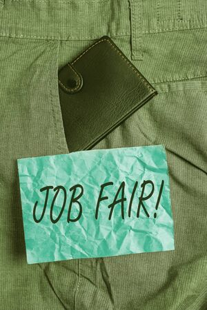 Text sign showing Job Fair. Business photo showcasing event where employers offer information about their companies Small little wallet inside man trousers front pocket near notation paper Stockfoto