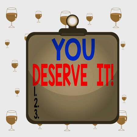 Text sign showing You Deserve It. Business photo text should have it because of their qualities or actions Clipboard colorful background spring clip stuck bind empty plank frame