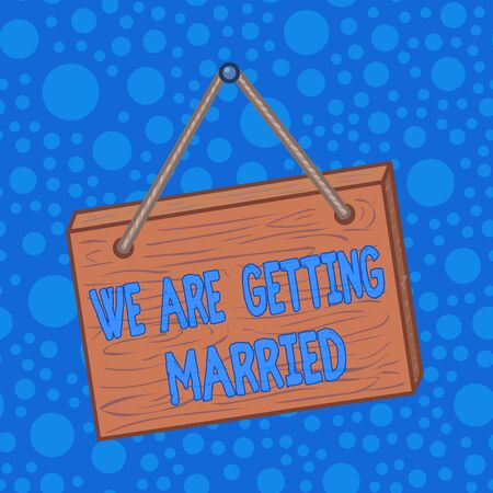 Word writing text We Are Getting Married. Business photo showcasing Engagement Wedding preparation Loving couple Square rectangle unreal cartoon wood wooden hang down on the coloured wall