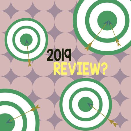 Writing note showing 2019 Review Question. Business concept for remembering past year events main actions or good shows Arrow and round target asymmetrical shape multicolour design Stock Photo