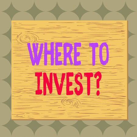 Conceptual hand writing showing Where To Invest Question. Concept meaning asking about where put money into financial schemes or shares Square rectangle unreal cartoon wood on the coloured wall