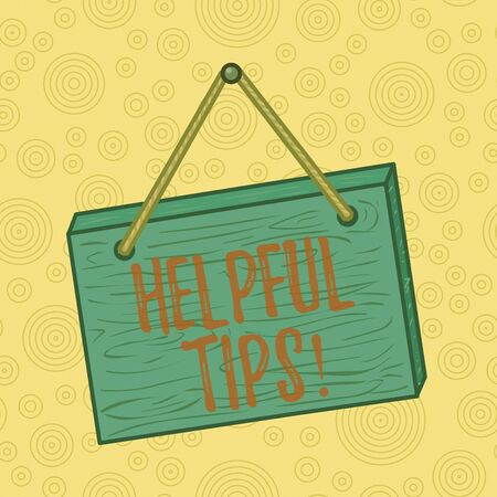 Handwriting text writing Helpful Tips. Conceptual photo advices given to be helpful knowledge in life Square rectangle unreal cartoon wood wooden hang down on the coloured wall