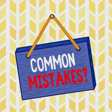 Text sign showing Common Mistakes Question. Business photo text repeat act or judgement misguided making something wrong Square rectangle unreal cartoon wood wooden hang down on the coloured wall Stock Photo