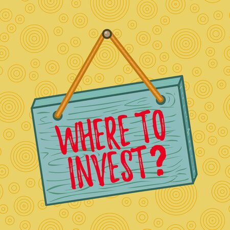 Handwriting text writing Where To Invest Question. Conceptual photo asking about where put money into financial schemes or shares Square rectangle unreal cartoon wood wooden hang down on the coloured wall