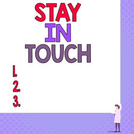 Conceptual hand writing showing Stay In Touch. Concept meaning Keep Connected thru Phone Letters Visit Email Social Media Young woman holding two hands right corner blank rectangle 版權商用圖片