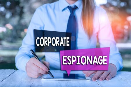 Handwriting text Corporate Espionage. Conceptual photo form of espionage conducted for commercial purpose Female business person sitting by table and holding mobile phone