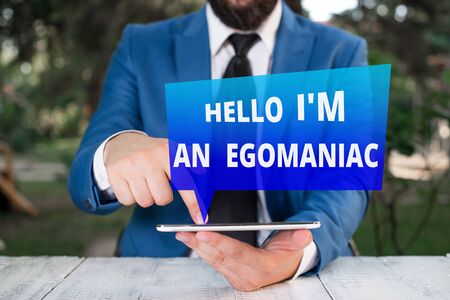 Text sign showing Hello I am An Egoanalysisiac. Business photo showcasing Selfish Egocentric Narcissist Selfcentered Ego Businessman with pointing finger in front of him
