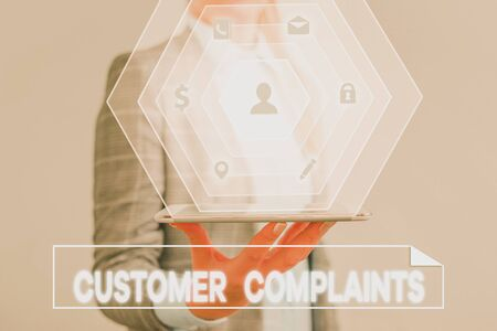 Conceptual hand writing showing Customer Complaints. Concept meaning expression of dissatisfaction on a consumer s is behalf Standard-Bild