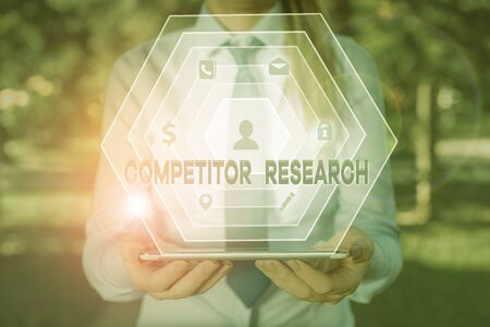 Handwriting text writing Competitor Research. Conceptual photo collection and review of information about rival firms