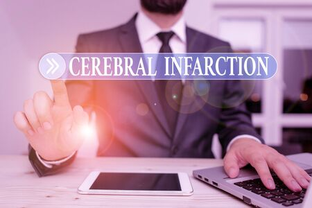 Writing note showing Cerebral Infarction. Business concept for focal brain necrosis due to complete and long ischemia Male human wear formal clothes present use hitech smartphone
