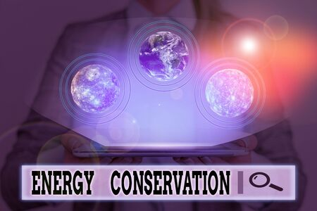Writing note showing Energy Conservation. Business concept for Reduction in the amount of energy consumed in a process Stock Photo