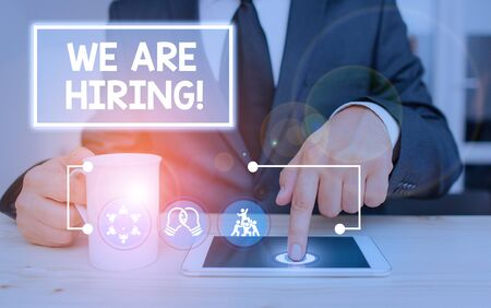 Writing note showing We Are Hiring. Business concept for recently you employ someone or pay someone to do particular job