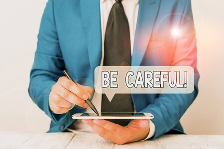 Text sign showing Be Careful. Business photo text making sure of avoiding potential danger mishap or harm Businessman pointing with pen in empty copy space