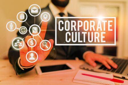 Writing note showing Corporate Culture. Business concept for beliefs and attitudes that characterize a company