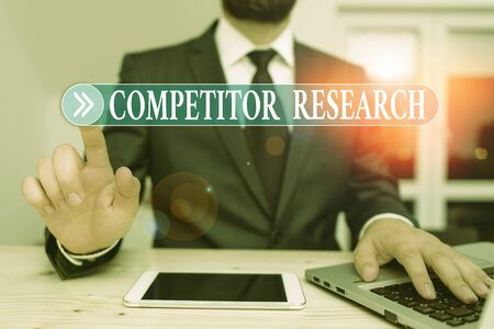 Writing note showing Competitor Research. Business concept for collection and review of information about rival firms Male human wear formal clothes present use hitech smartphone