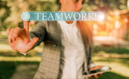 Handwriting text writing Teamwork. Conceptual photo combined action of group especially when effective and efficient Business woman in the nature pointing with the finger into empty space