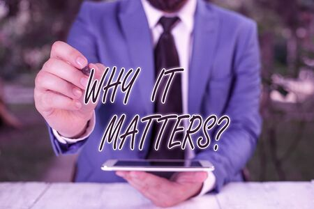 Word writing text Why It Matters Question. Business photo showcasing most important thing to be done when involved in situation Businessman pointing with pen in empty copy space